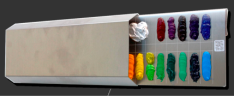 Camille Przewodek's Paint Saver Palette sits at the top of your mixing area, and it provides airtight storage when not in use.