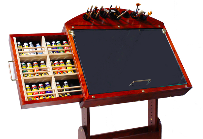 One of many Craftech painting tables with paint and brush storage.