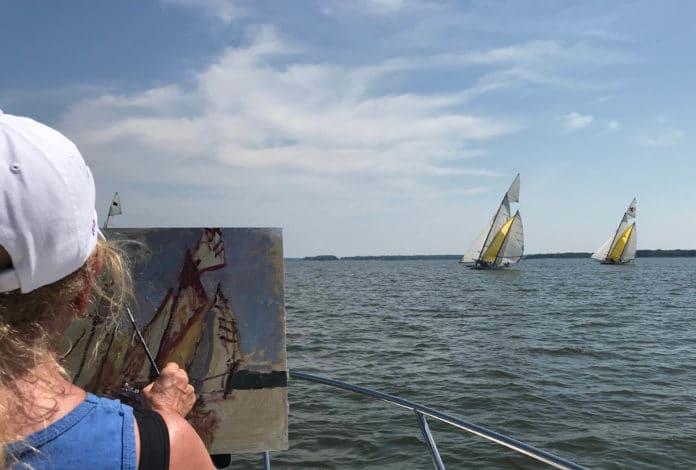 Debra Huse plein air painting on a boat